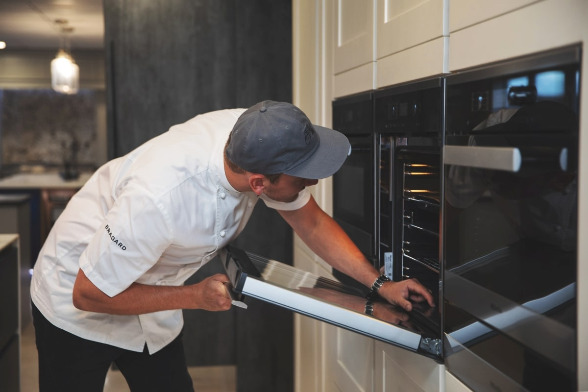 chef looking into oven